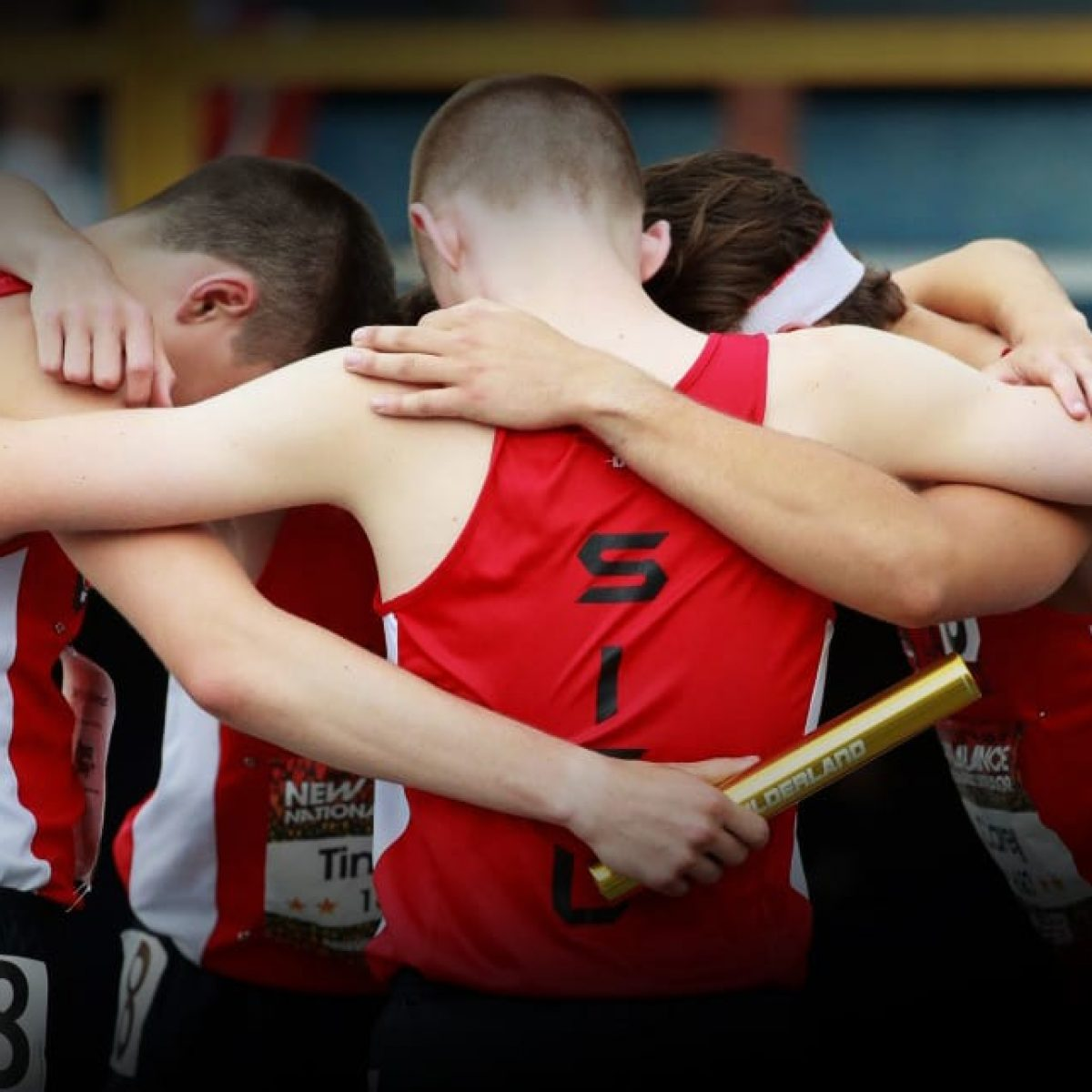 Track Team with Personalized relay baton (RelayBatons.com)